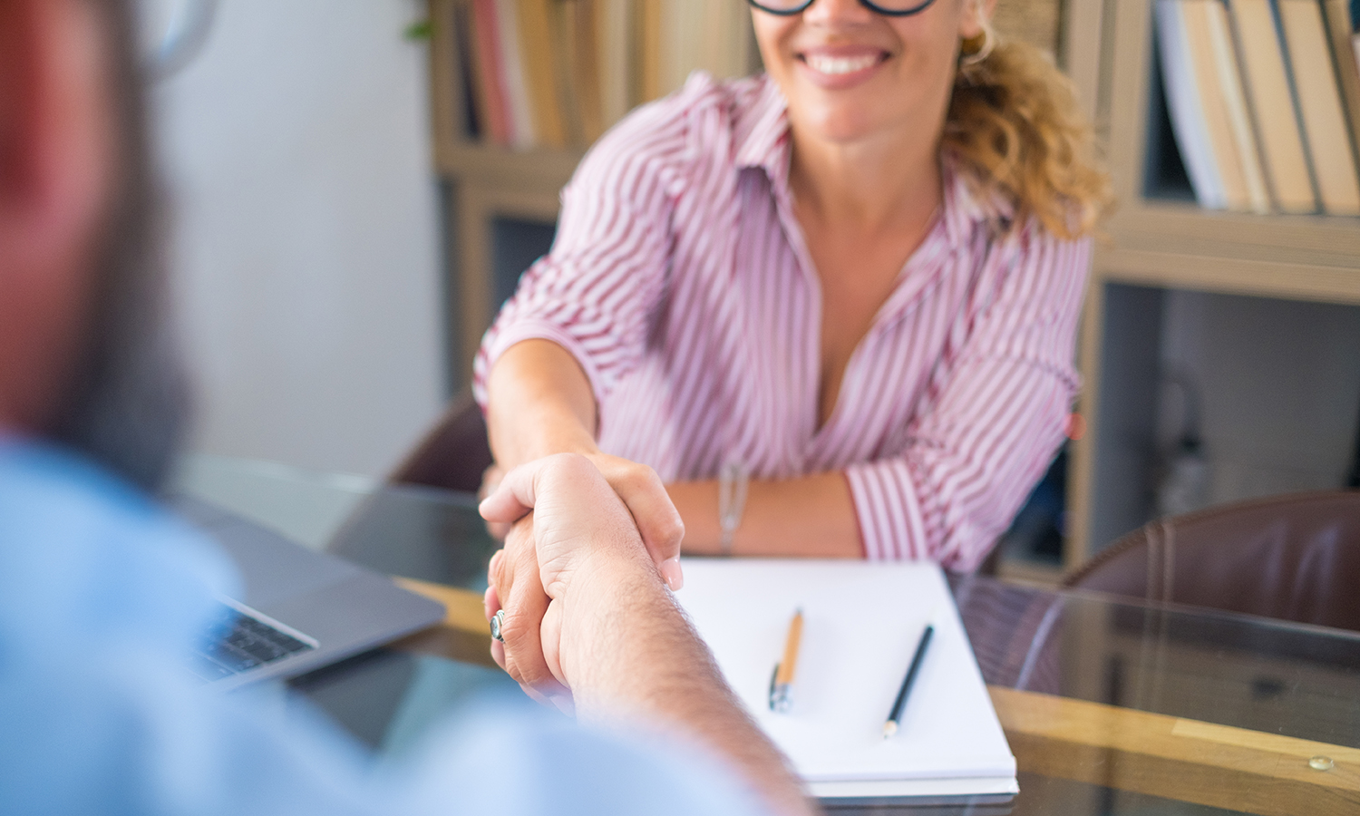 Woman shaking hands in good faith agreement