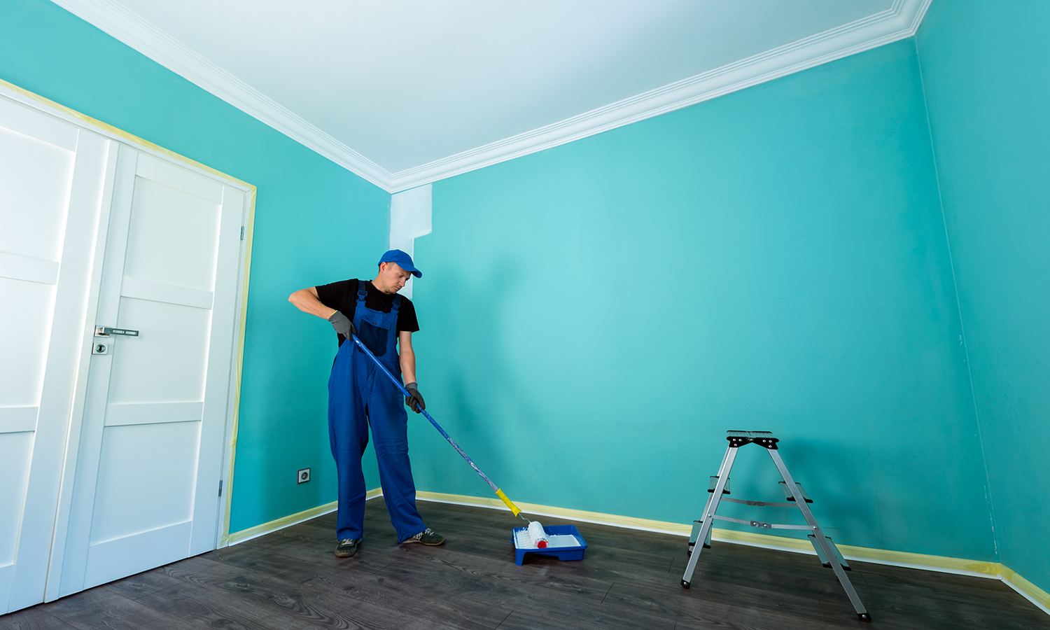 man painting new house