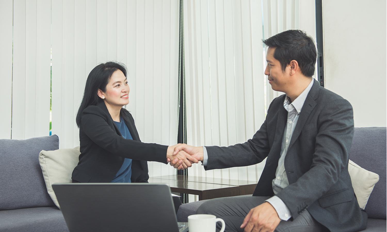 real estate agents negotiating the sale of a house