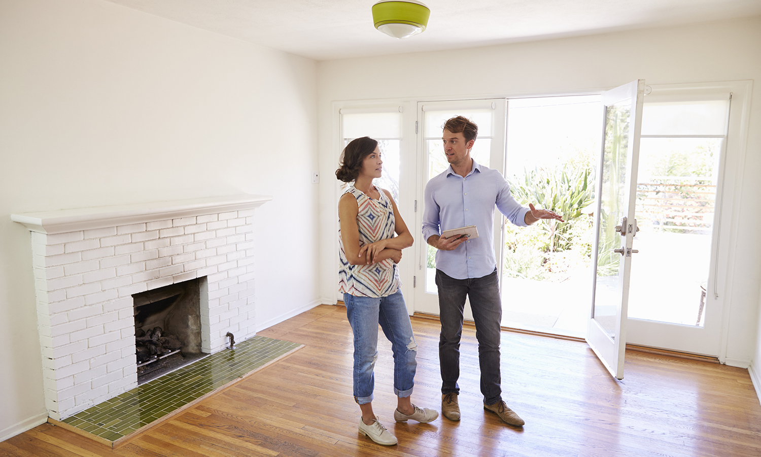 realtor showing a home buyer a home