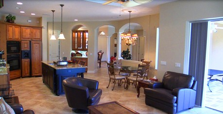 Long view of the Kitchen, Family, Dining and Living Rooms at 3566 Founders Club Dr, Sarasota, FL