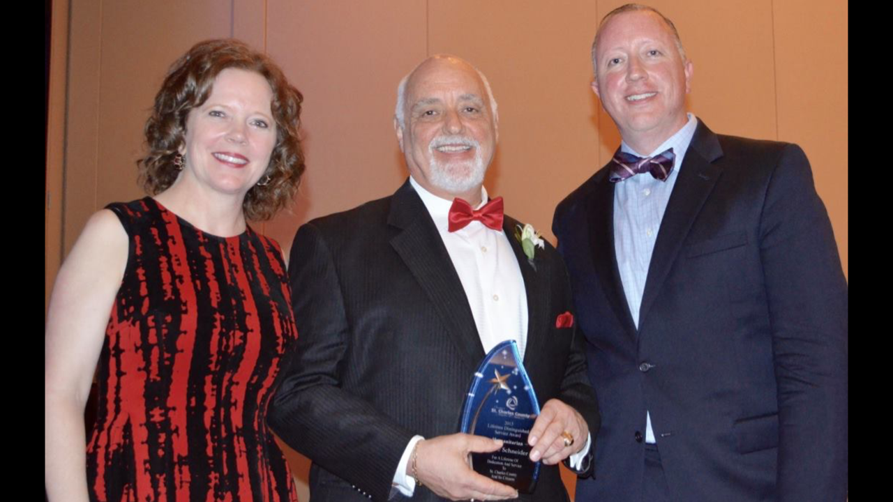 Merle accepting the Greater St. Charles Chamber of Commerce's Lifetime Service Award in the Humanitarian category - 2015.