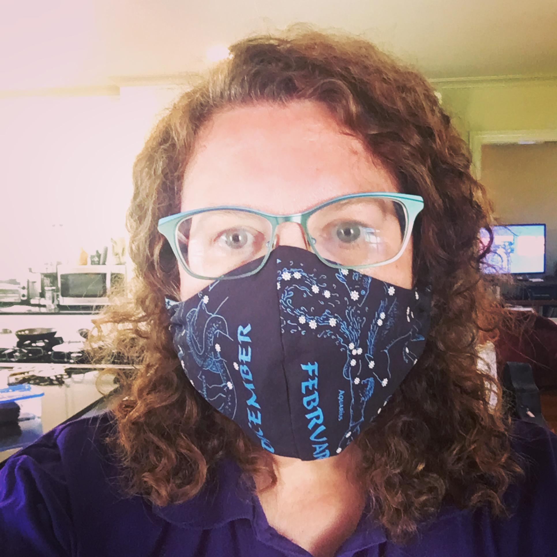 Leslie wearing a mask