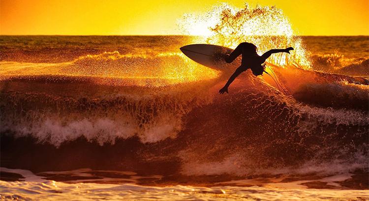 Ocean wave and surfing dude www.SellHomesInBrooklyn.com