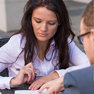 woman signing mortgage contract