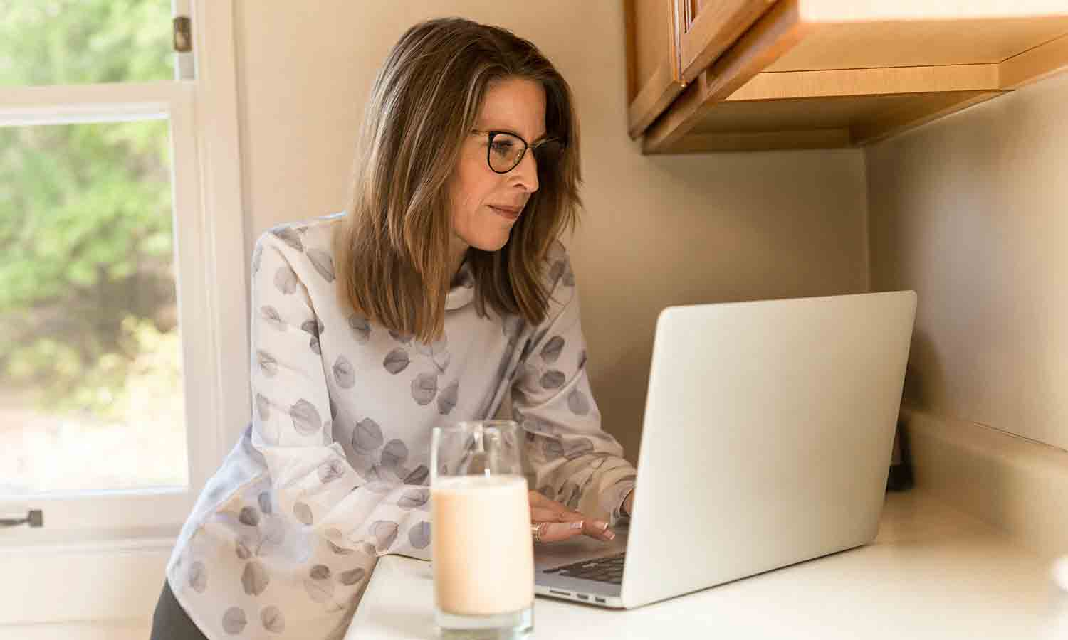 woman using the internet inside her house