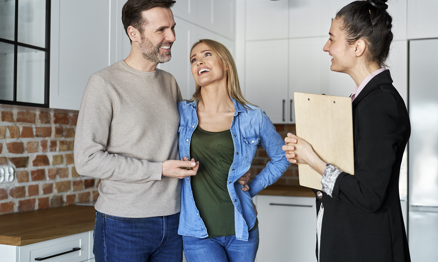 couple excited about selling their house quickly