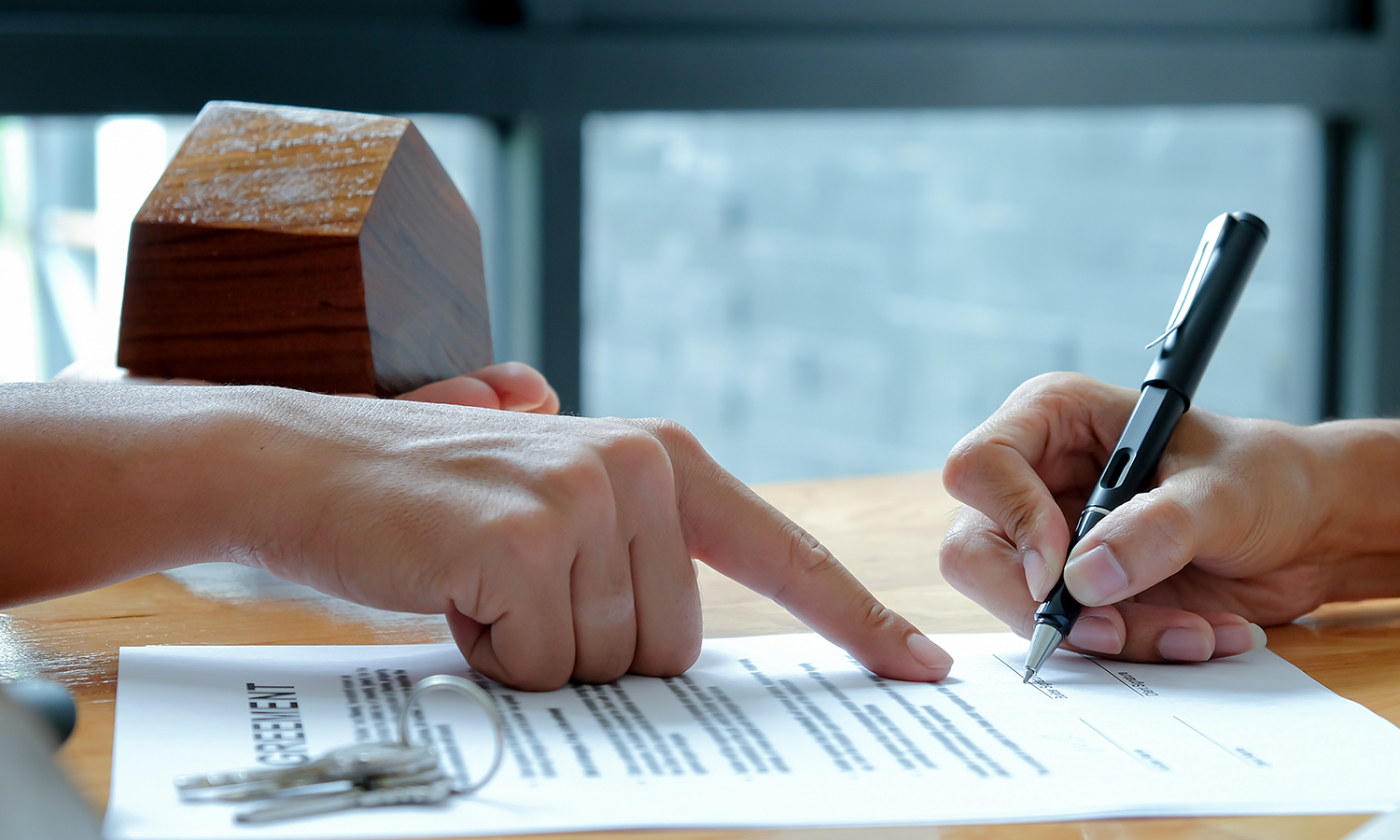 first-time home buyer signing purchase agreement