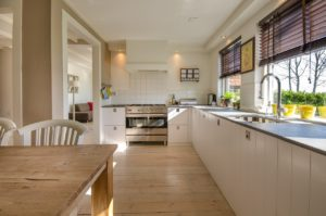Spacious open kitchen with wood floors.