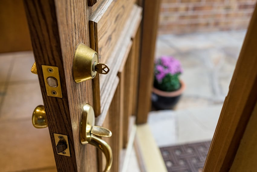 A front door with a key in the lock.