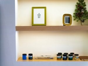 A built-in wall shelf with small trinkets.