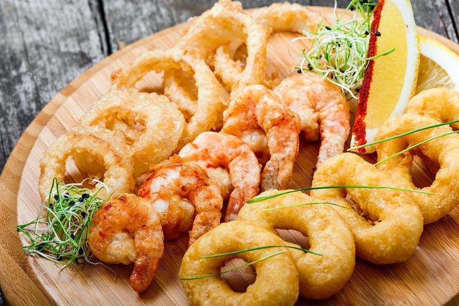 Kirkwood home owners eat fresh seafood.
