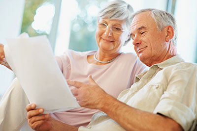Senior Couple Reviewing Prop 90 Information