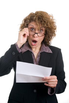 Woman holding a supplemental tax bill