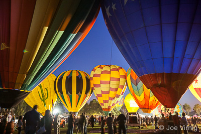 Multiple Balloons lit up at the Santa Paula Balloon Festival