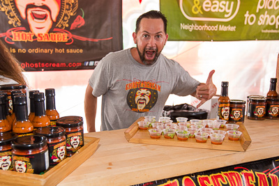 Man with salsa samples at the Oxnard Salsa Tent