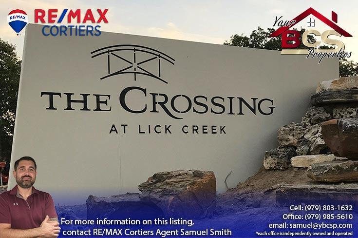 crossing at lick creek college station texas neighborhood sign