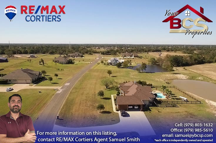 tuscany trace college station aerial view of home with pool