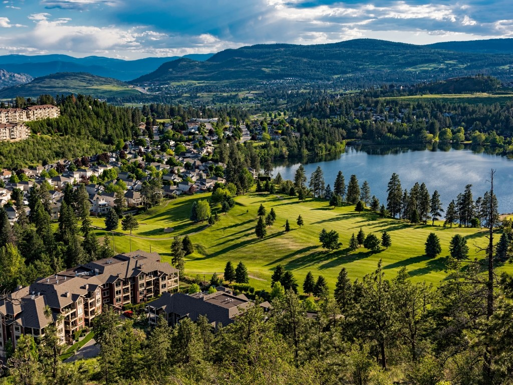 view of golf course, lake, and real estate in west kelowna, bc