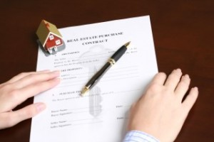 Signing a contract to purchase real estate.